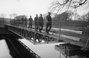West Indian troops in the Royal Engineers walking across a bridge they had just constructed.
