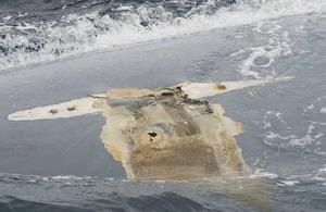 Photograph of Cheeki Rafiki's upturned hull taken by crew of USS Oscar Austin on 23 May 2014