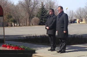 Keith Allan and Martin Harris laying flowers at the memorial