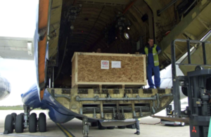 Photograph of a aid supplies being loaded onto an aircraft