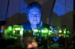 Ceres Imaging CEO Dr Ian Redmond in his lab, illuminated by green laser light
