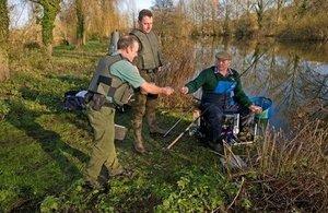 Bailiffs checking rod licences