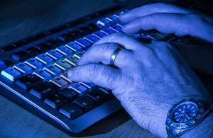 Man typing on a keyboard