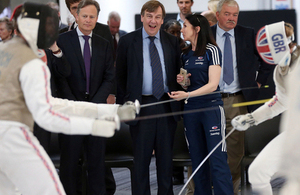 John Whittingdale watches a fencing bout at British Fencing's new centre in Hendon