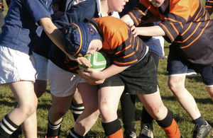 Boys playing rugby
