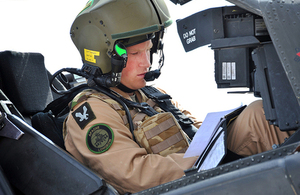HRH Prince Harry in an Apache helicopter