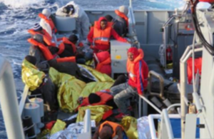 Migrants on board HMC Protector after being rescued by Border Force officials