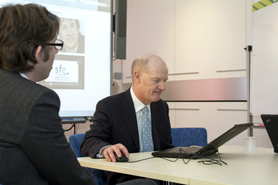 David Willetts completing the online student loan application process