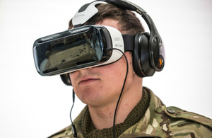 Soldier demonstrating a virtual reality headset.