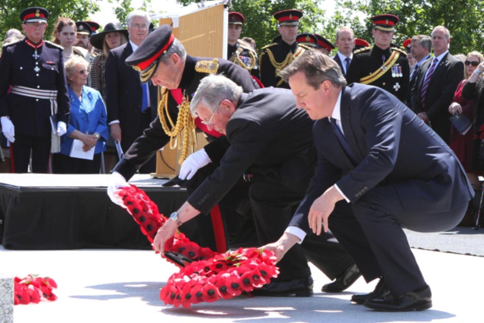 The Prime Minister David Cameron, The Chief of Defence Staff General Sir Nicholas Houghton and Mr Peter Andrews, father of Flight Sergeant Gary Andrews, 120 Squadron, Royal Air Force lay wreaths at the memorial