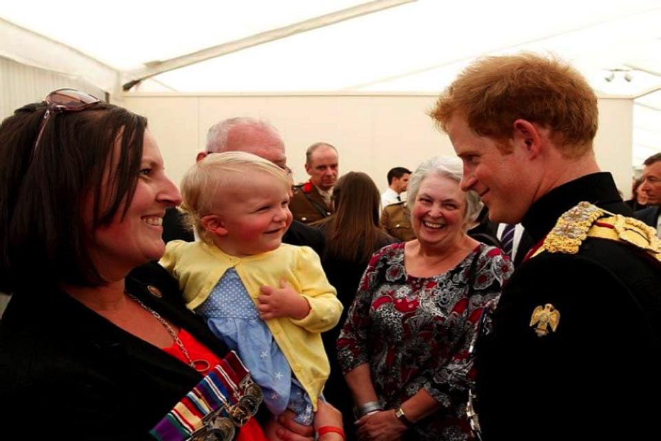 Prince Harry with Tracey and Lainey Walters, wife and daughter of the later Corporal James Walters