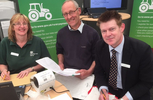 RPA helping a farmer to apply for BPS at an agricultural show