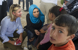 International Development Secretary Justine Greening (left) meeting Syrian refugees in Jordan. Picture: Scott Hornby/Sun