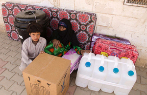 A Yemeni woman and child with an aid kit distributed by Save the Children. Picture: Save the Children/M. Awadh