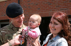Lance Corporal Neely, his wife Rachel and their daughter are given the keys to their new home
