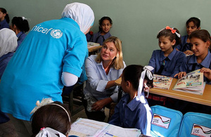 Justine Greening speaking to Syrian refugee children and a UNICEF worker in Jordan. Picture: UNICEF