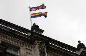 Union Flag and rainbow flag flying over the Cabinet Office building, 70 Whitehall.