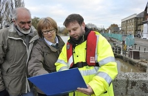 An Environment Agency officer with two flood wardens.