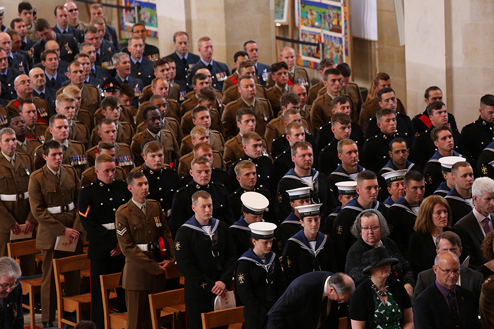 Servicemen and women attend the service of celebration for Armed Forces Day