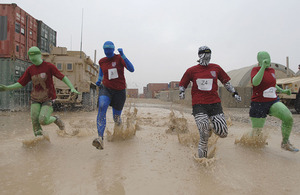 Half-marathon relay race runners in fancy dress at Headquarters Task Force Helmand in Lashkar Gah