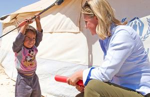 International Development Secretary Justine Greening meeting a Syrian refugee boy in Jordan. Picture: Scott Hornby/Sun