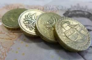 pound coins and ten pound notes
