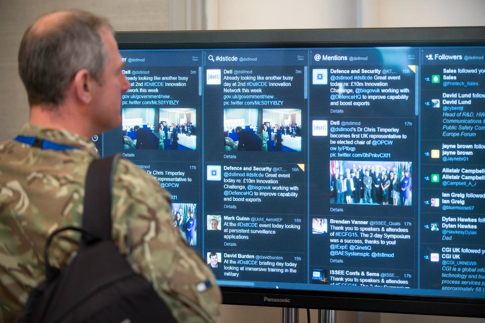 Military Advisor viewing social media screen.