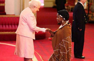 Angel Benedicto receiving her Queen's Young Leaders Award from Her Majesty Queen Elizabeth II