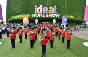 A military band opens last year's Ideal Home Show