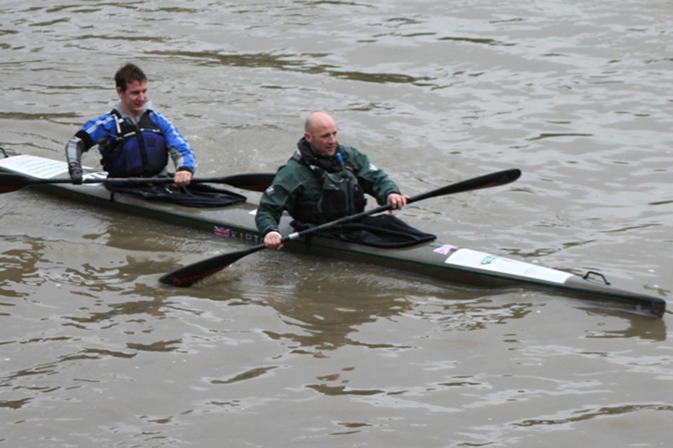 Royal Marines Captain Jon White and Colour Sergeant Lee John Waters in their canoe on the River Thames