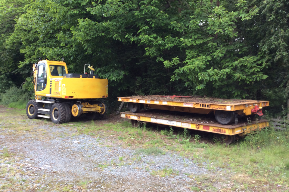 Image showing the road rail vehicle and trailers used to collect the scrap sleepers (image courtesy of Network Rail)