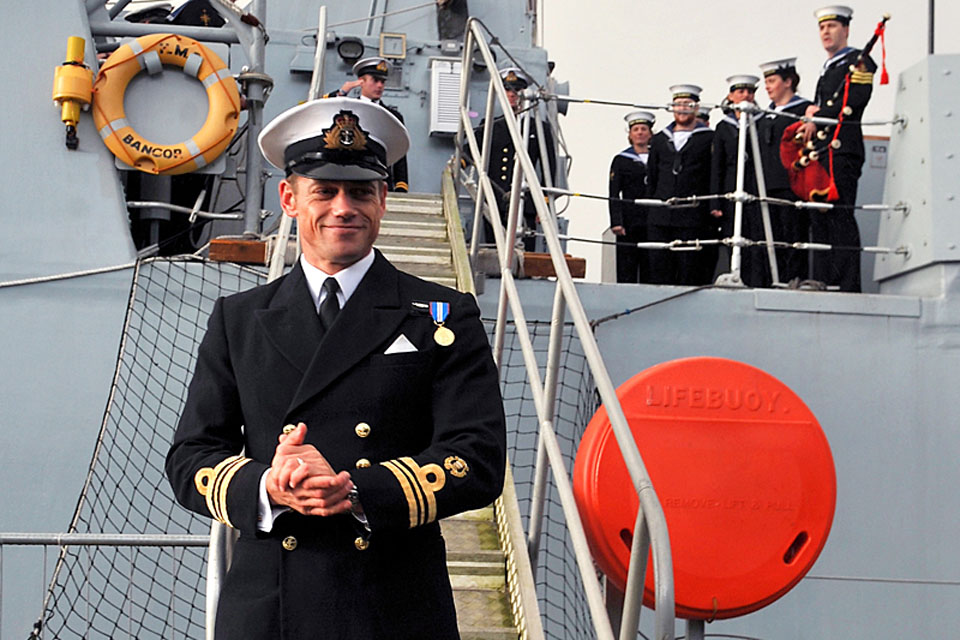 HMS Bangor's Commanding Officer, Lieutenant Commander Neil Marriott, steps onto dry land at Faslane after 120 days at sea