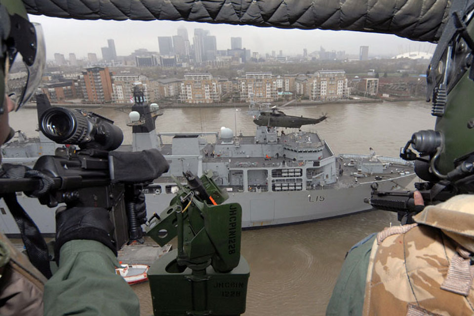 Flight deck activities on HMS Bulwark observed by the crew of a Sea King helicopter