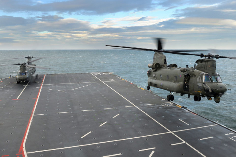 One of the Chinook helicopters takes off from the deck of HMS Bulwark