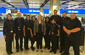 Karen Bradley with Border Force officers at Heathrow