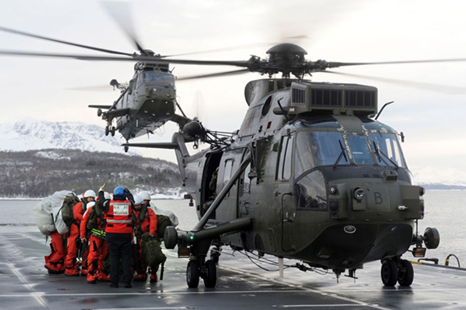 A vertical replenishment via helicopter involved the transfer of 90 Royal Marines commandos from HMS Illustrious to HMS Bulwark