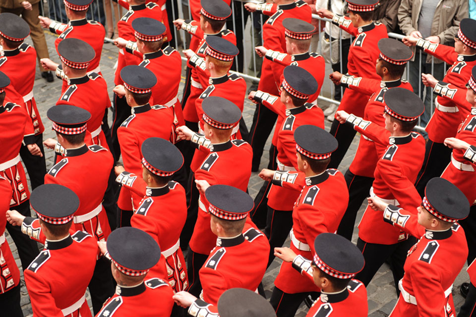 Members of the Scots Guards march down the Royal Mile in Edinburgh during Armed Forces Day 2011
