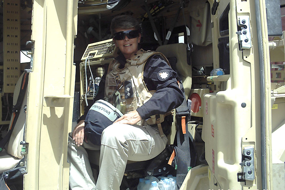 Temporary Inspector Jane Underwood in a Husky armoured vehicle