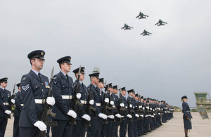 Four Tornado aircraft fly overhead as members of 14 Squadron RAF parade for the final time at RAF Lossiemouth in Scotland