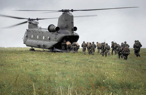 Troops from 1st Battalion The Royal Irish Regiment board a Chinook support helicopter during 16 Air Assault Brigade's final pre-deployment training exercise on Salisbury Plain