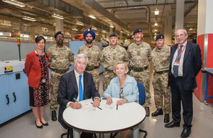 Royal Mail CEO Moya Green signing the Armed Forces Covenant with Secretary of State for Defence Michael Fallon