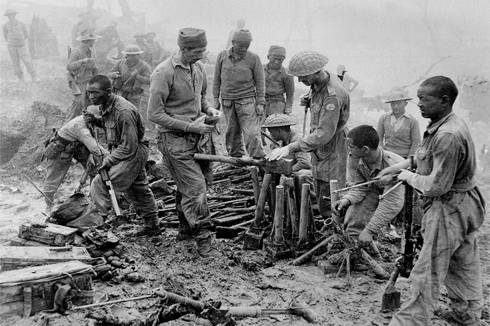 Indian and Gurkha soldiers inspect captured Japanese ordnance during the Imphal-Kohima battle, 1944 (Copyright NAM)