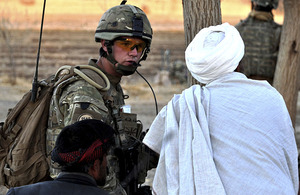Corporal Jamie Williams speaks with an Afghan man in Alokozi Shah, south of Popalzai Kalay, near Helmand's capital, Lashkar Gah