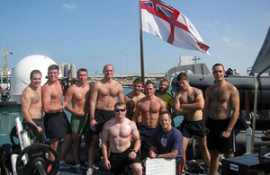 Each of eleven crew members from HMS Pembroke lifted heavy weights over 1,700 times to raise money for charity whilst the ship was alongside in Abu Dhabi