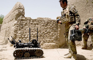 A soldier from 15 Field Support Squadron operates a Talon remote-controlled robot which forms part of the latest counter-IED technology