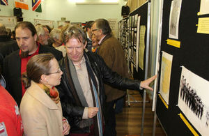 Jeremy Silvester, MAN, explains the exhibition quiz to HE Mrs Marianne Young