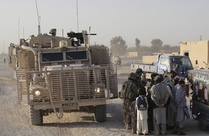 British soldiers dismount from a Mastiff armoured patrol vehicle to chat with locals in Lashkar Gah