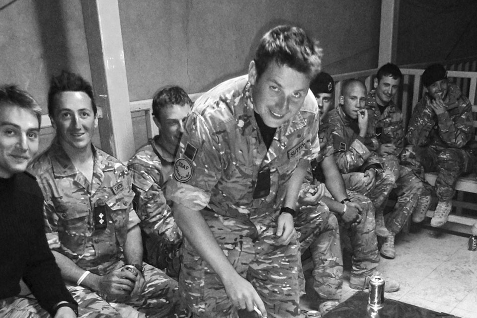 Soldiers from the 2nd Royal Tank Regiment take a break from operations to enjoy some cake and alcohol-free beer as part of their Cambrai Day celebrations in Helmand