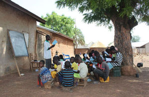 Children being taught in an outdoor classroom in northern Ghana.Tackling tax evasion will enable Ghana to invest revenues into public services such as education.