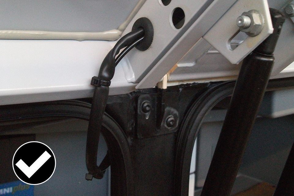 Allowed: good example or wires that have been clipped and fitted in a rubber grommet.